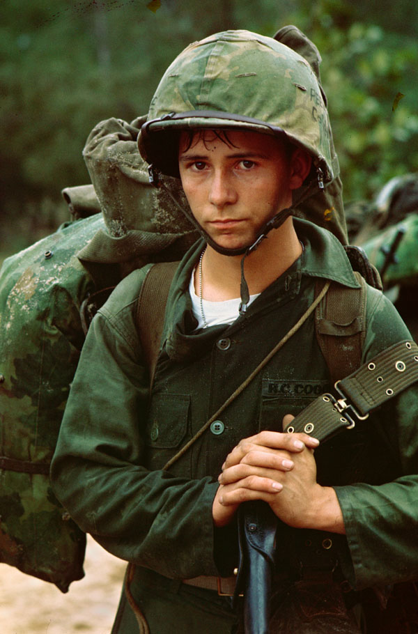 A young U.S. Marine waits on the beaches of Da Nang, Vietnam.