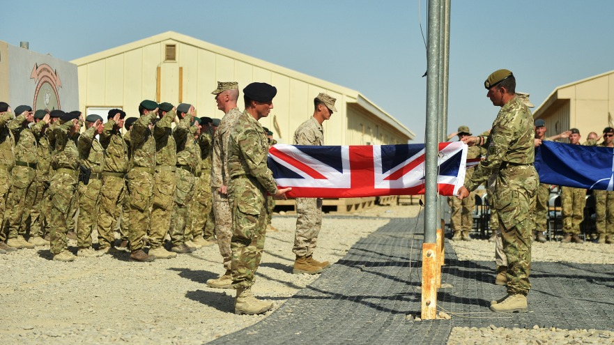 U.K. troops lower the Union Jack at Camp Bastion
