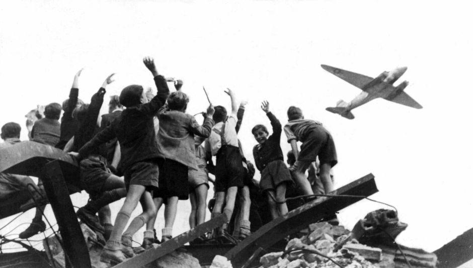 German children greet American C-47 aircraft bearing food