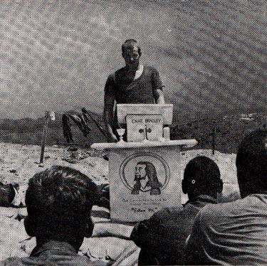A soldier gives his testimony at a pulpit made by the men of B battery, 6/33 Artillery