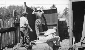 CPS workers assembling a privy at Camp 27