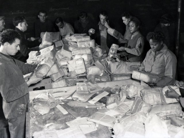 WACs sorting army mail in France in 1945