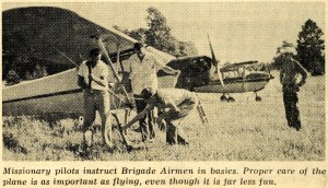 A February 3, 1964 Brigade photo showing members learning aircraft mechanics. Other Brigade activities included rifle practice and camping (Standard) - Bethel University Digital Library