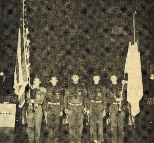 Brigade members at attention. The flag at right appears to be the Christian flag, designed in 1907 by Charles Overton (February 3, 1964 Standard) - Bethel University Digital Library