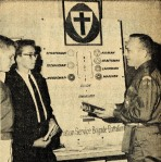 A Brigade leader explains different organizational ranks to young men (April 13, 1964 Standard) - Bethel University Digital Library