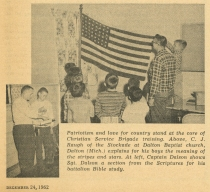 A 1962 Brigade setting demonstrating the patriotic - but still civilian - nature of the organization (December 24, 1962 Standard) - Bethel University Digital Library