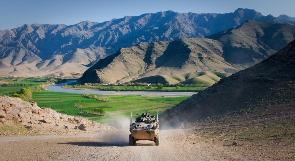 An Australian service light armored vehicle drives through Tangi Valley, Afghanistan, March 29. The terrain of Tangi Valley is notoriously rough, but the ASLAV maneuvers across it with ease, said Australian army Lt. McLeod Wood, a troop leader for 2nd Cavalry Regiment, Mentoring Task Force 2, Combined Team Uruzgan.